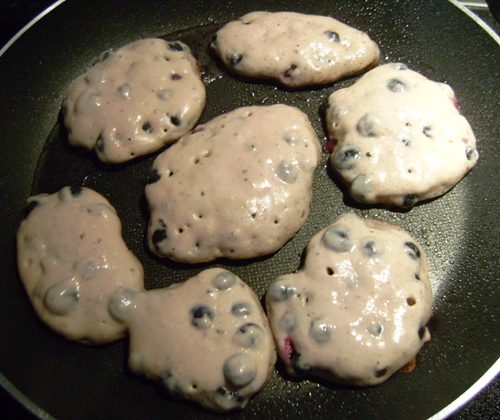 blueberry pancakes frying pan ready to flip