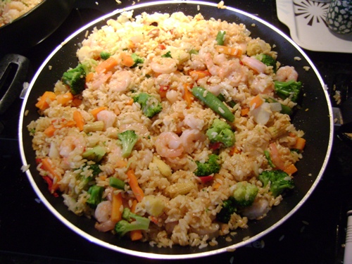 shrimp fried rice on the frying pan