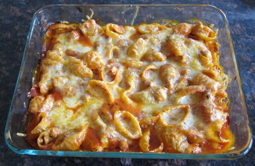 cooked baked pasta shells casserole picture in a baking dish