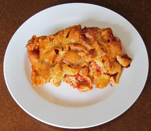 baked pasta shells casserole on a white plate