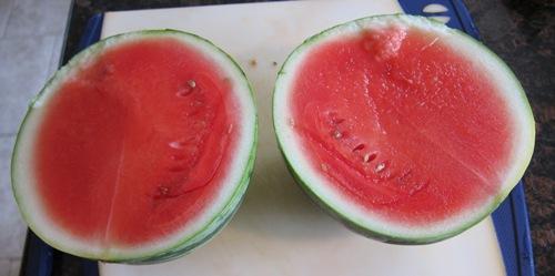 red juicy watermelon cut in half