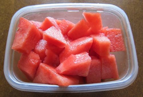 watermelon chunks in a plastic bowl