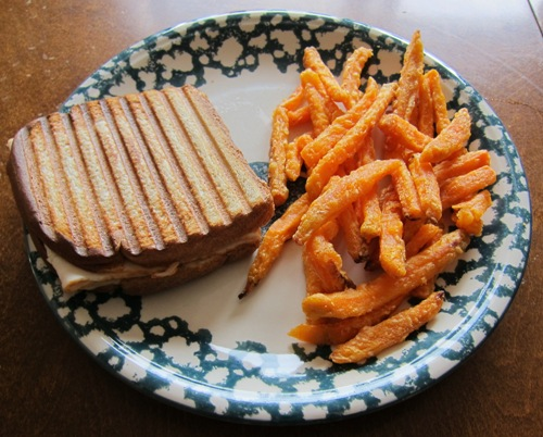 sweet potato fries with turkey and cheese grilled panini sandwich