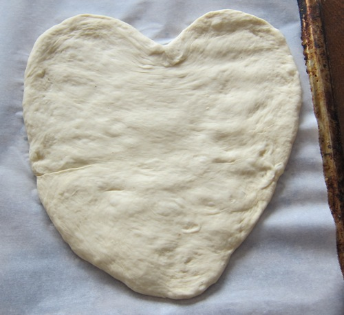 pizza dough rolled into a heart shape