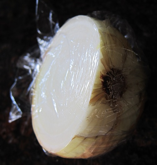 onion half wrapped in plastic wrap