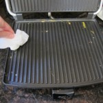 cleaning a panini press with a paper towel