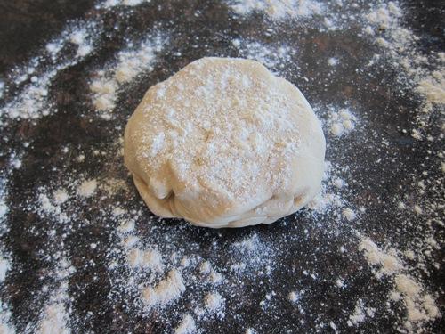 ball of dough sprinkled with flour