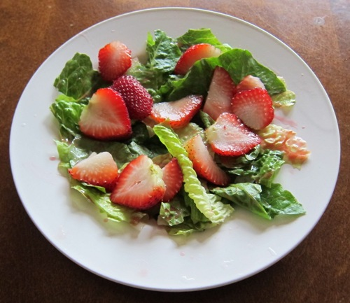 salad with lettuce and sliced strawberries