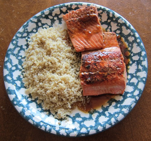 salmon teryaki on a plate served with quinoa
