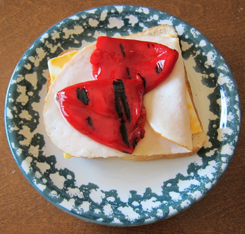 marinated sweet red bell peppers on a sandwich