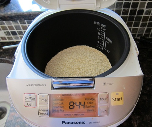 putting quinoa in a rice cooker