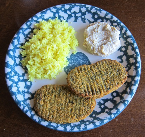 hummus with veggies patties and yellow rice