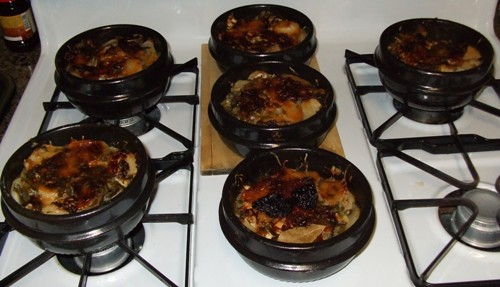 baked chicken and potatoes in 6 clay pots