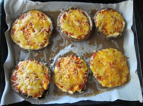 portobello mushroom pizzas on a baking sheet