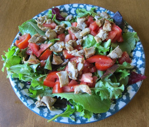 main dish salad with chicken, lettuce and tomatoes