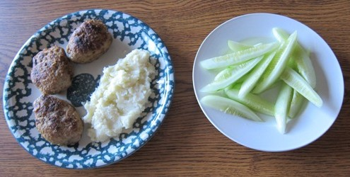 russian meat patties (kotlety) with mashed potatoes and cucumber spears