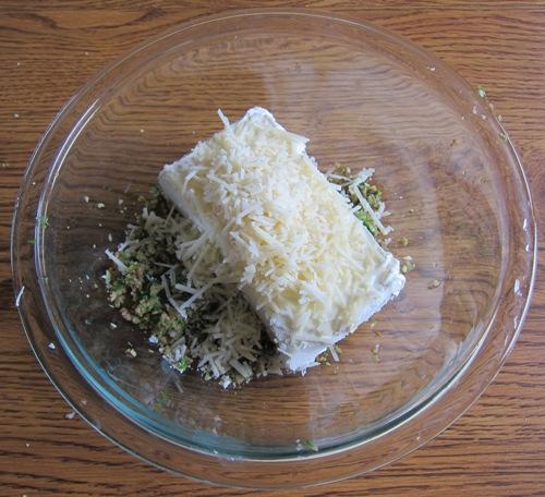 adding parmesan cheese to stuffed mushrooms filling