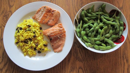 salmon with yellow rice and edamame