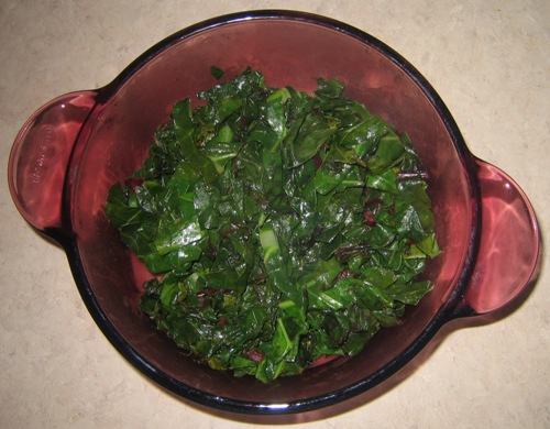cooked beet greens in a bowl