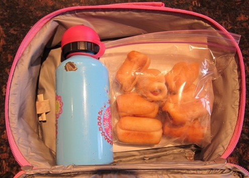 packing bagel dogs in a lunch box
