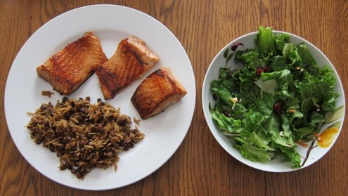 dinner of salmon teryaki rice pilaf green salad