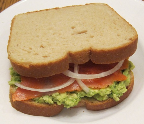 lox sandwich with avocado and onion