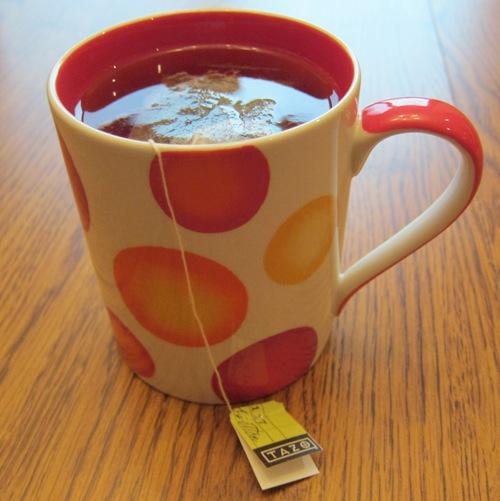 tazo om green tea in a cup