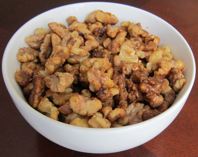 a bowl of candied walnuts appetizer