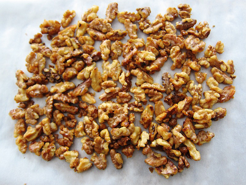 candied walnuts on a baking sheet drying