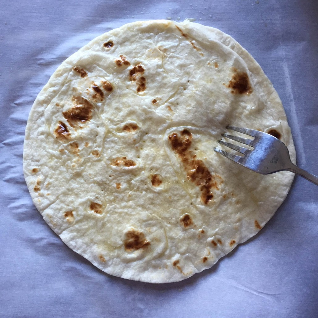 Pricking tortilla with a fork