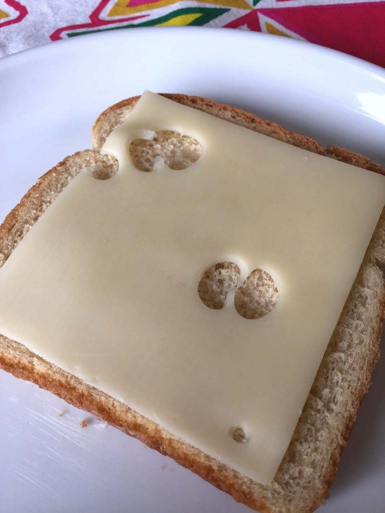 Slice of cheese on bread