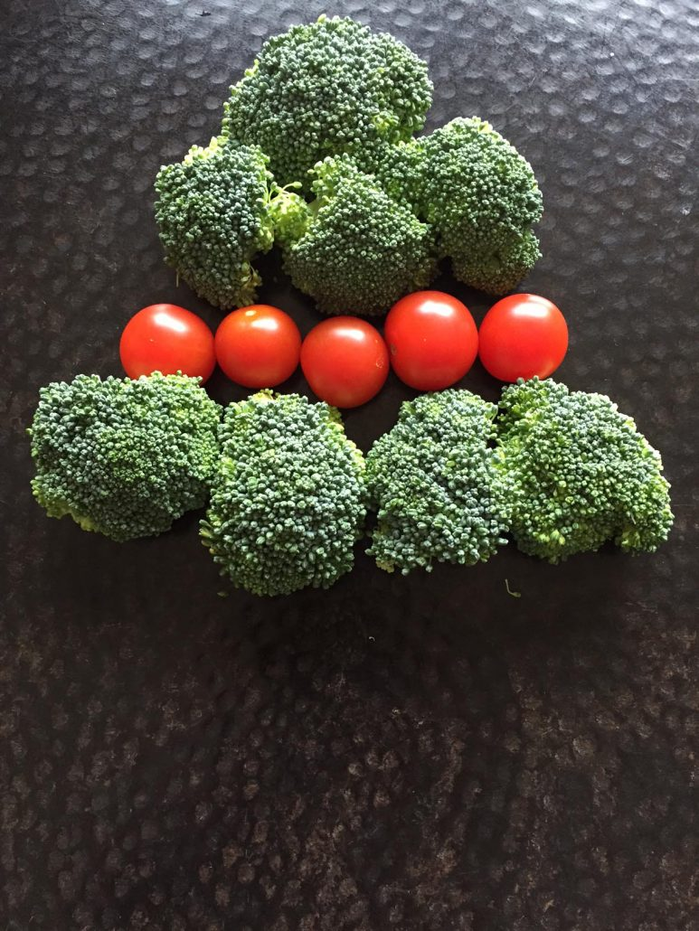 Christmas Tree Made Out Of Broccoli And Tomatoes