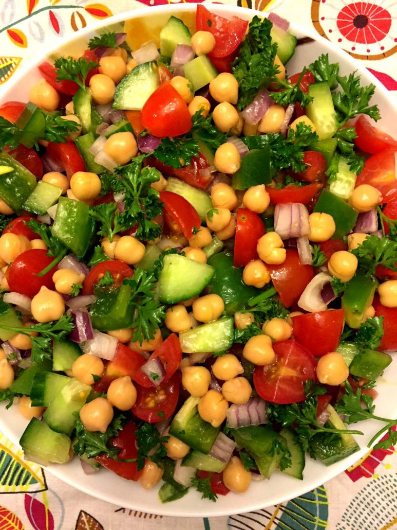 Chickpea Salad With Tomatoes Cucumbers Onions And Green Peppers