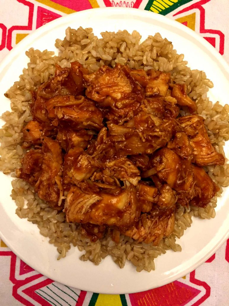 Plate of BBQ chicken served over rice