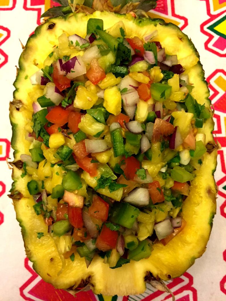 Pineapple Shell Bowl Filled With Fresh Pineapple Salsa