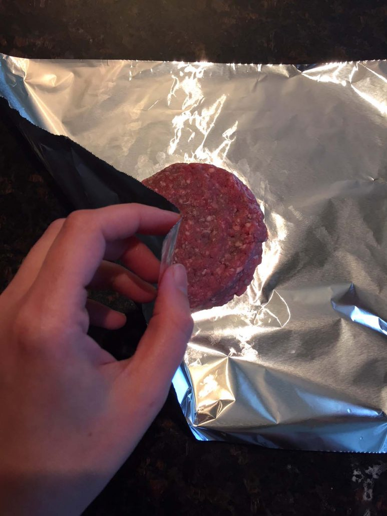 Burger patty wrapping in foil