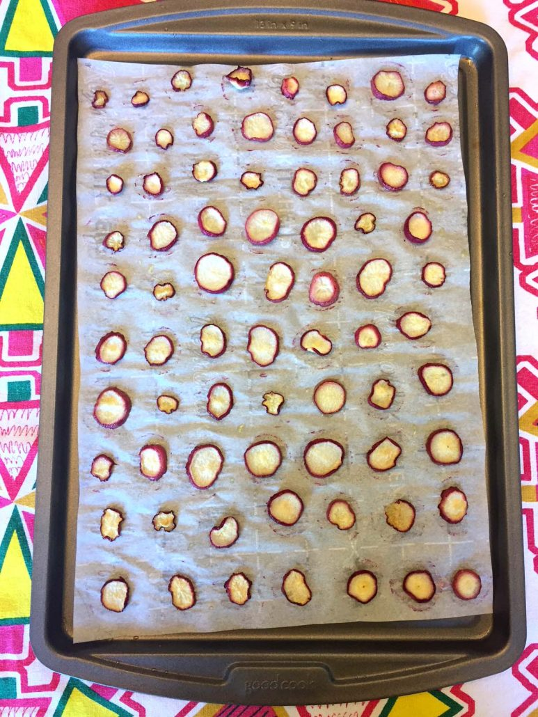 Radish chips on a baking sheet