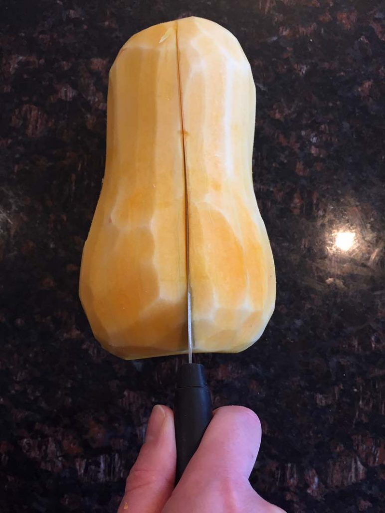 cutting butternut squash in half