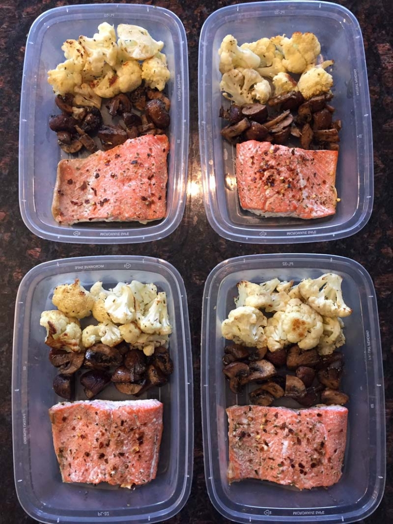 keto meal prep containers with salmon cauliflower mushrooms