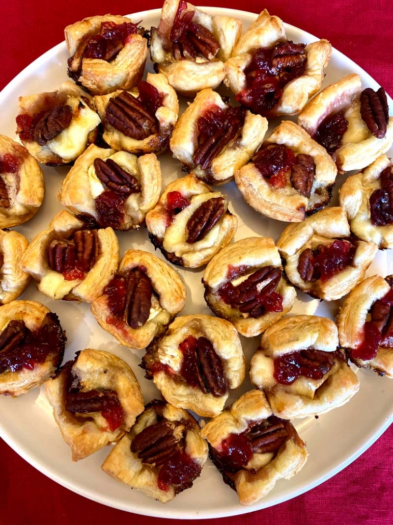 puff pastry cups with melted brie and cranberry sauce