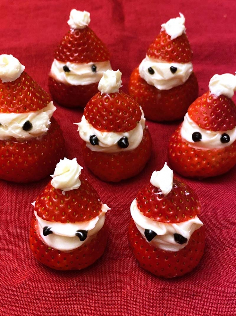 strawberry santa hats with whipped cream and marshmallows