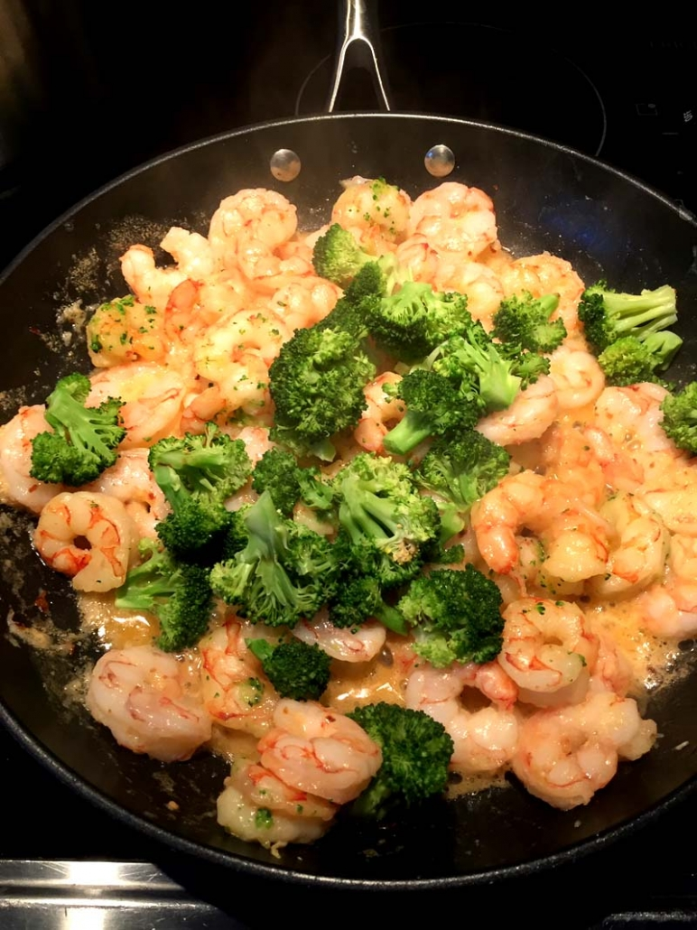 shrimp broccoli butter on a frying pan