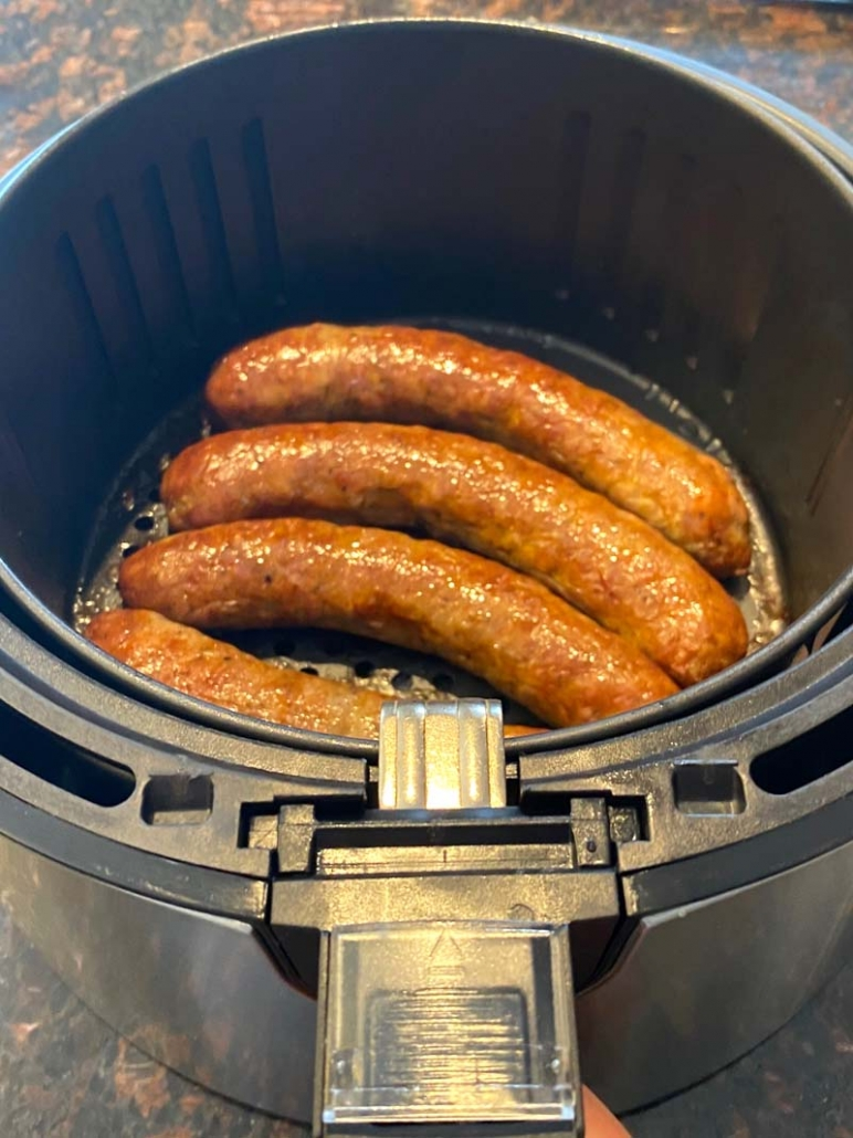 cooked sausages in air fryer basket