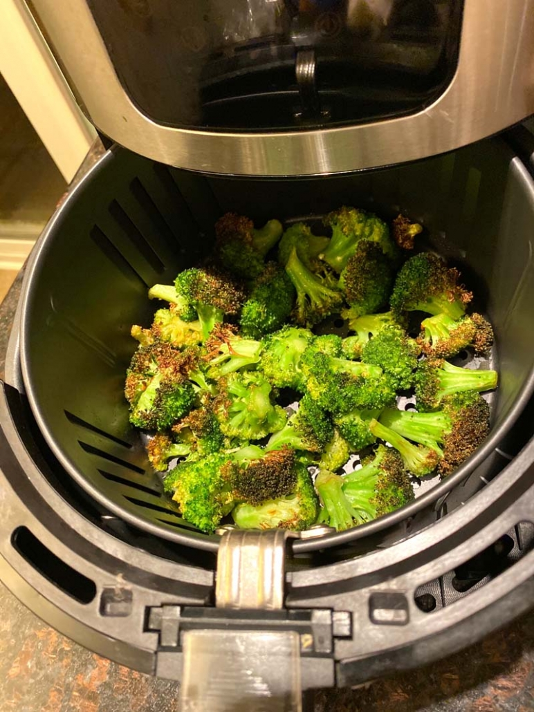 cooking roasted broccoli in an air fryer