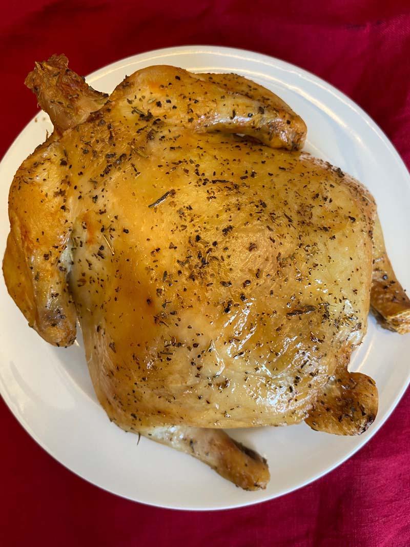 cornish hen on a white plate