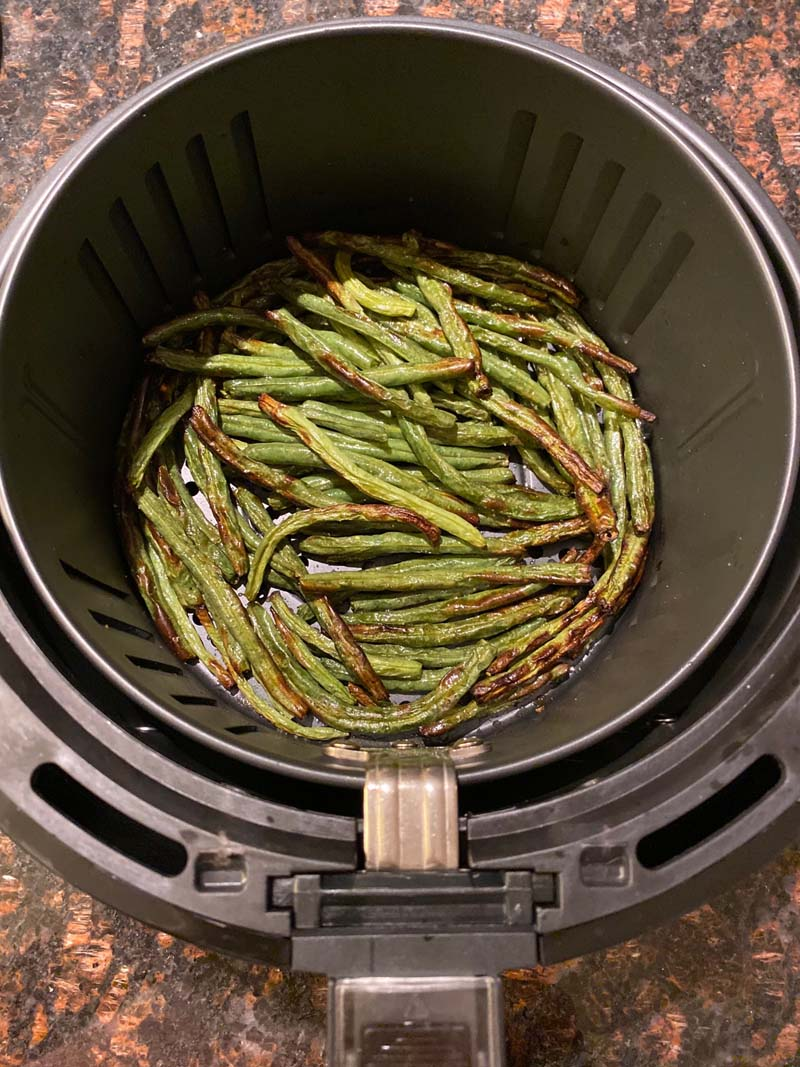 Air Fryer Green Beans in air fryer basket on a countertop
