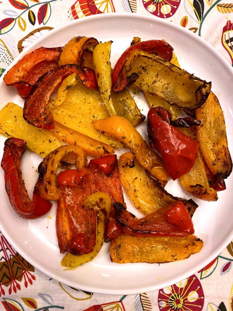 Roasted bell pepper pieces cooked in an air fryer on a white plate.