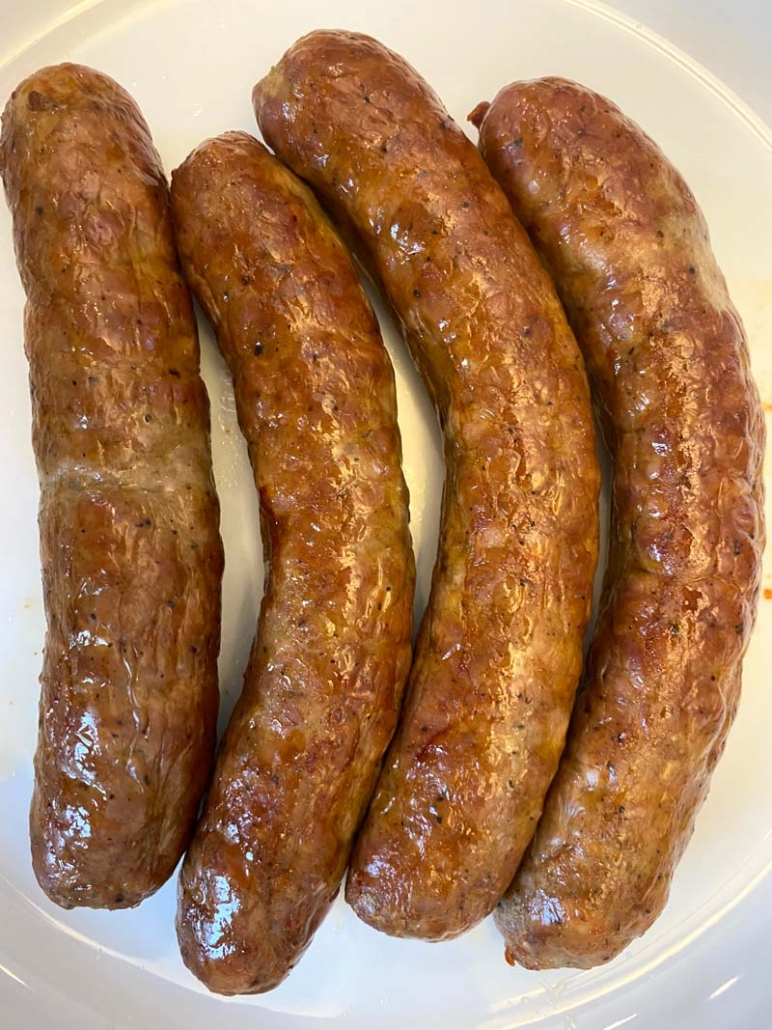 roasted italian sausages on a white plate
