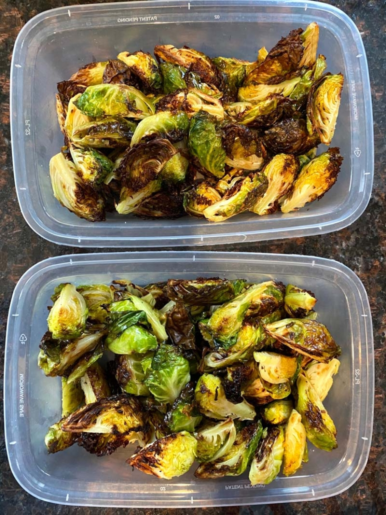 meal prepping brussel sprouts in clear containers