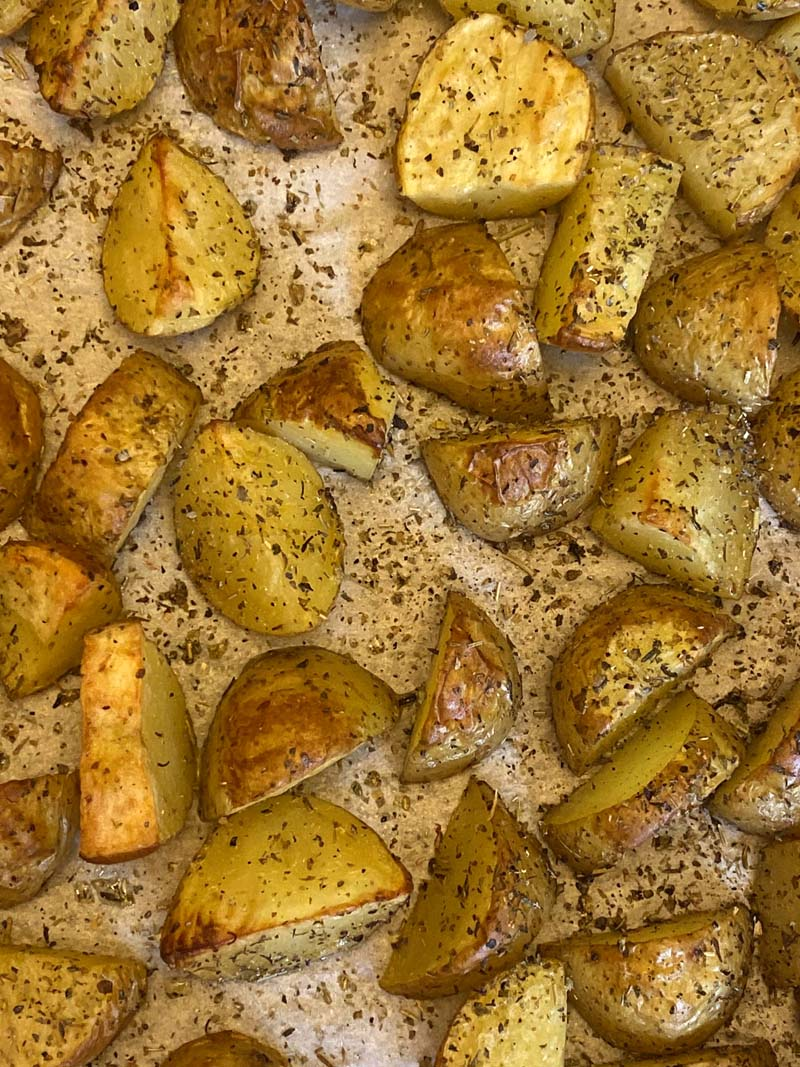 Parchment paper covered with herb roasted potatoes